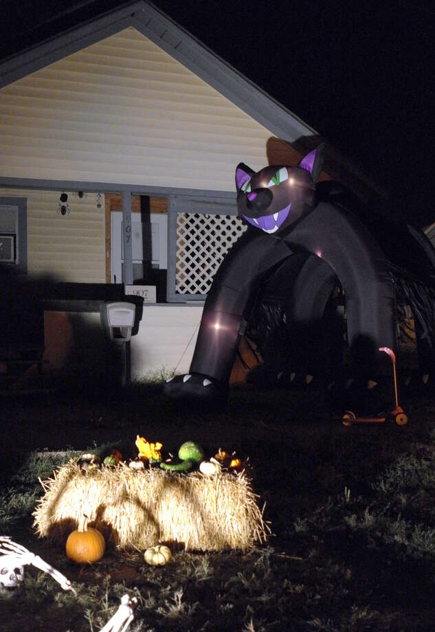 John Sigwald/Courtesy PhotoAn inflatable black cat stands guard outside the front door of a residence in the 900 block of Kokomo, ready to pounce on any stray vampires, zombies, ghosts and goblins intent doing mischief on All Hallow Eve, now more commonly known as Halloween.
