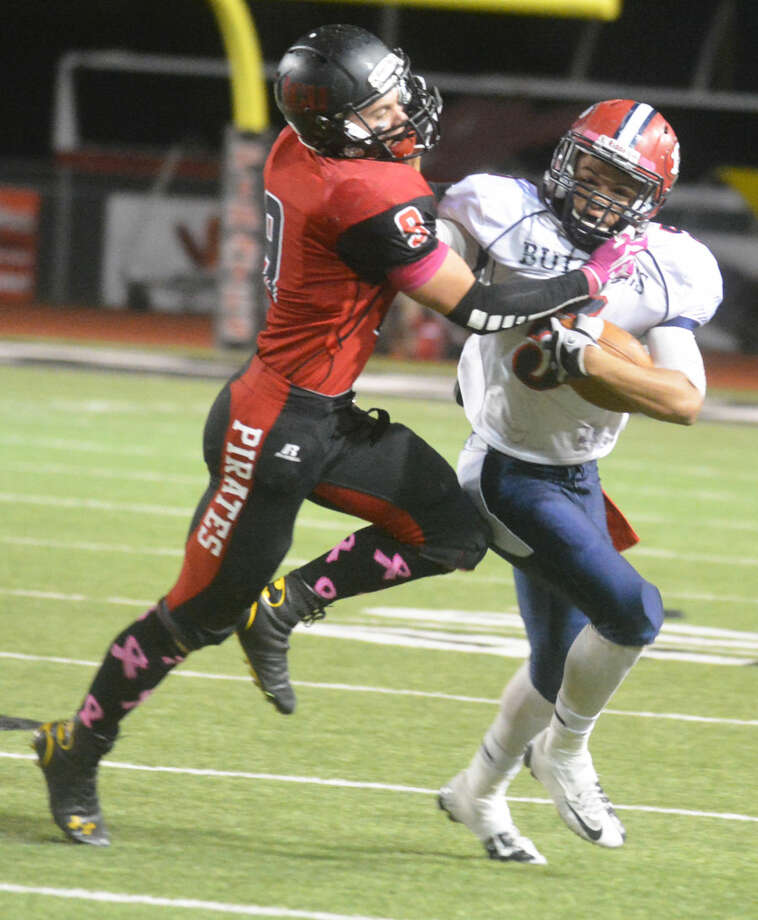 Plainview running back Warren Flye (right) tries to fight off a tackle by Lubbock Cooper's Tycer Farmer (left) during last week's football game. Flye has rushed for more than 1,300 yards this season. The Bulldogs play their final home game Friday against San Angelo Lake View. Photo: Skip Leon/Plainview Herald