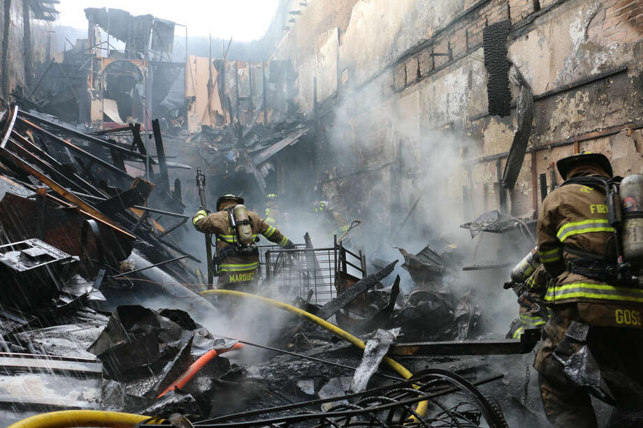 Philip Mize/Plainview Fire MarshalPlainview firefighters search for hot spots inside Nina's Gift Shop on Sunday after a morning fire gutted the downtown business at 107 E. Sixth. Although the structure and its contents are considered to be a total loss, aggressive work by firefighters kept the blaze from spreading to adjoining buildings.