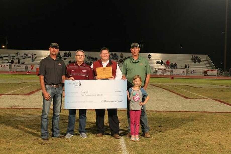 Courtesy Photo Monsanto representative Kirk Marnell presents representatives of Tulia Independent School District with a $10,000 grant from America's Famers Grow Rural Education, sponsored by the Monsanto Fund.