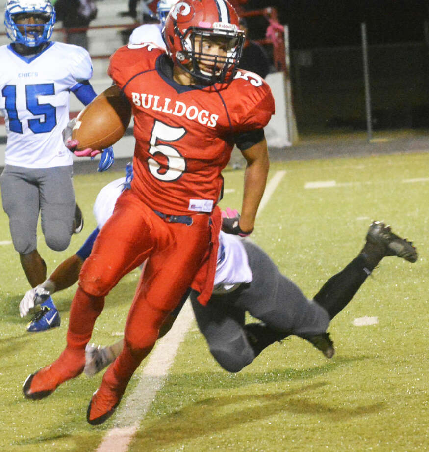 Plainview's Warren Flye leaves a San Angelo Lake View tackler sprawled on the ground as he races around end to gain yardage Friday night. Flye ran for 504 yards on 21 carries to set a Plainview single-game rushing record. He broke the old mark of 466 yards set by Jamar Wall in 2005. Photo: Skip Leon/Plainview Herald
