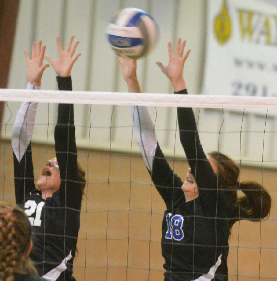 Plainview Christian Academy's Shalin Lawson (left) and Laura Beth Earhart (right) were two of four Lady Eagles voted to the all-district volleyball first team. Photo: Skip Leon/Plainview Herald