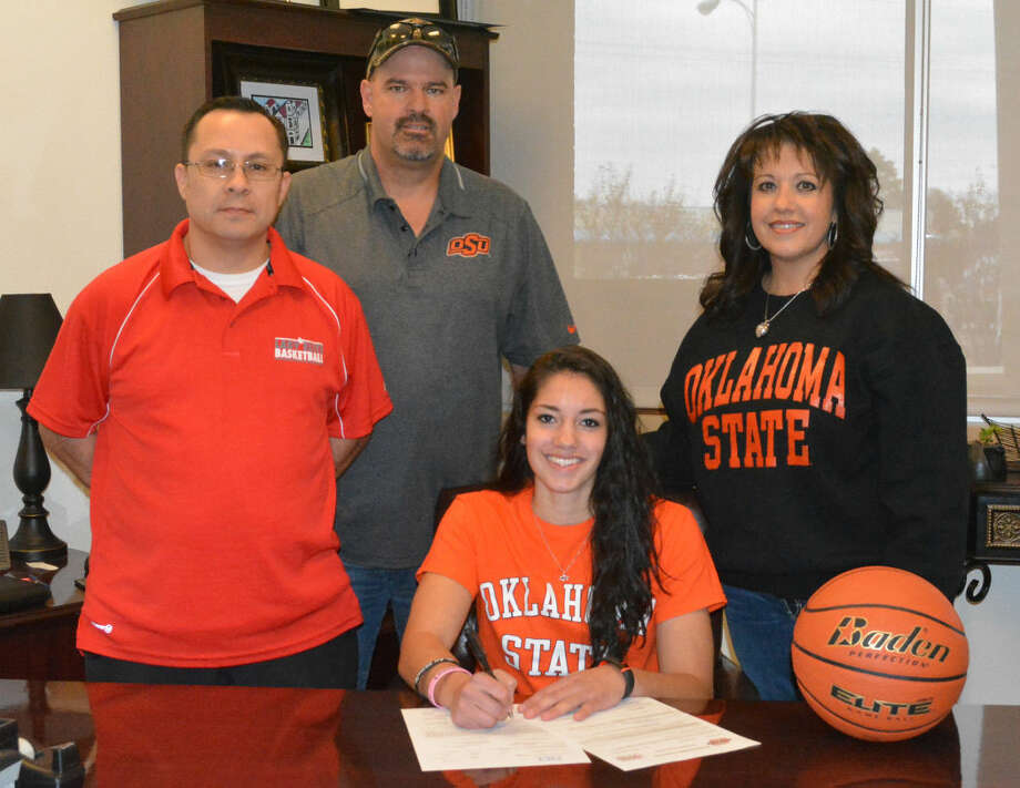 Plainview Lady Bulldog basketball player Karli Wheeler made it official Wednesday and signed a national letter of intent to play for Oklahoma State University next year. Wheeler had previously made a verbal commitment to Oklahoma State during the summer. Pictured (from left) are Jeff Gonzales, Wheeler's coach with the West Texas Lady Elite AAU team the past 10 years; her dad, Jason Wheeler; Karli, and her mom, Kaylene Wheeler. Photo: Skip Leon/Plainview Herald