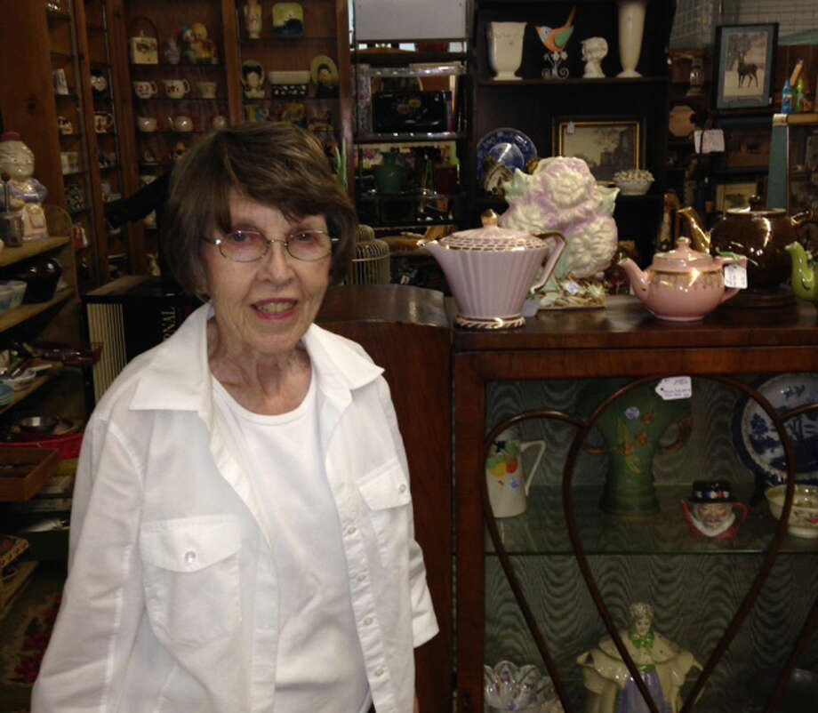 Nancy Hagood stands in front of one of her five booths at Uniques & Antiques in downtown Plainview. Hagood has been with the antiques and collectibles mall since it opened 20 years ago. She is the only original dealer still with the store. Photo: Courtesy Photo
