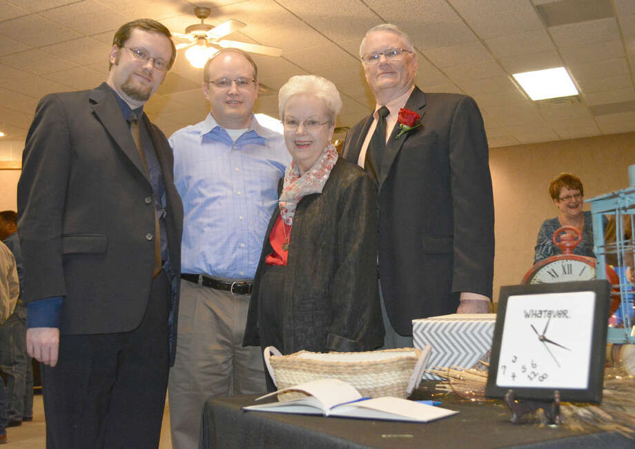 Retiring District JudgeDoug McDonough/Plainview HeraldRetiring 242nd District Court Judge Ed Self (right) and his wife of 50 years, Mary Anna, are joined by their sons Mitchell (left) of Plainview and Mark of Austin at a retirement reception in his honor Friday at the Hale County Justice Center. Self, who was appointed to the bench in 1998 by Gov. George W. Bush, will retire at the end of his current term on Dec. 31 after 16 years. His successor is Kregg Hukill. Self plans to travel and serve as a visiting judge.