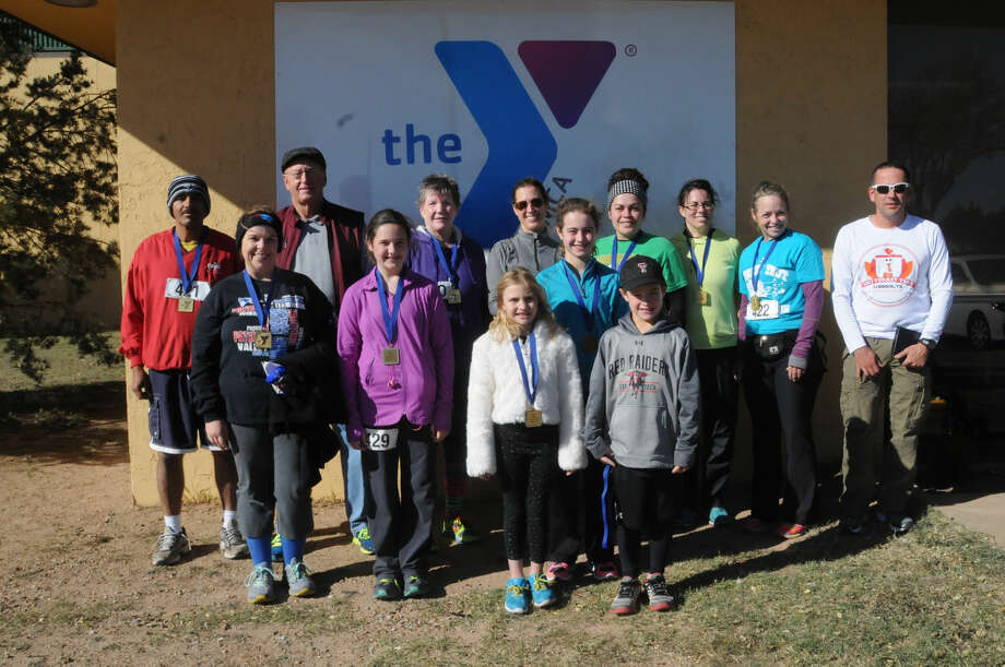 First place winners in their respective divisions at Saturday's annual YMCA Turkey Trot include Crystal Fuston (front left), Lexi Gonzalez, Mallory Ruhland, Hannah Massingill, Sam Massingill, Manuel Botello (back left), Dean Thompson, Shelley Gammage, Gretchen Massingill, Jennifer Walton, Ashley Knight, Raynie Sageser and Martin Montalvo.