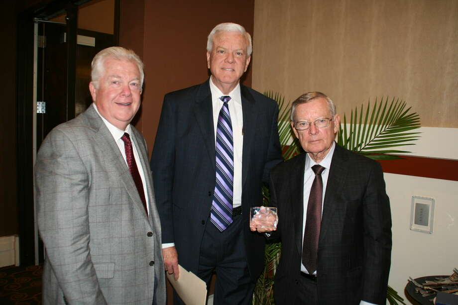 WBU Photo Mike Melcher (left), executive director of university advancement, and President Dr. Paul Armes (center) present the Spirit of Philanthropy award from Wayland to Delbert McDougal.