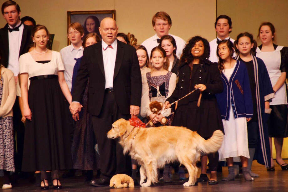 The dog Sandy is played by Kevin and Nancy Lewis' dog Quest. Cast members shown are Parker Adamson, Claire Hukill, Josh Turpen, Lauren Hukill ( partially hidden), Walter Wright, Kambry Roberts, McKayleigh Moore, Maddi Murphree, Trevor Townsend, Sidnie Thomas, Reece Hastey, Lexie Saenz, Rylee Smock and Sage Gregory. Photo: Jan Seago | Courtesy Photo