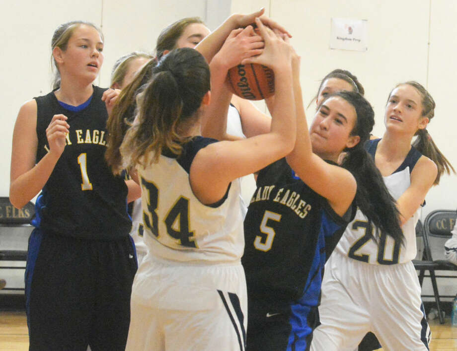 Plainview Christian Academy's Mallory Bennett (5) battles two Kingdom Prep players for a rebound as teammate Kylee Hill (1) looks on during a game at the Cotton Center Tournament Friday. The Lady Eagles won the game, 45-19. Photo: Skip Leon/Plainview Herald