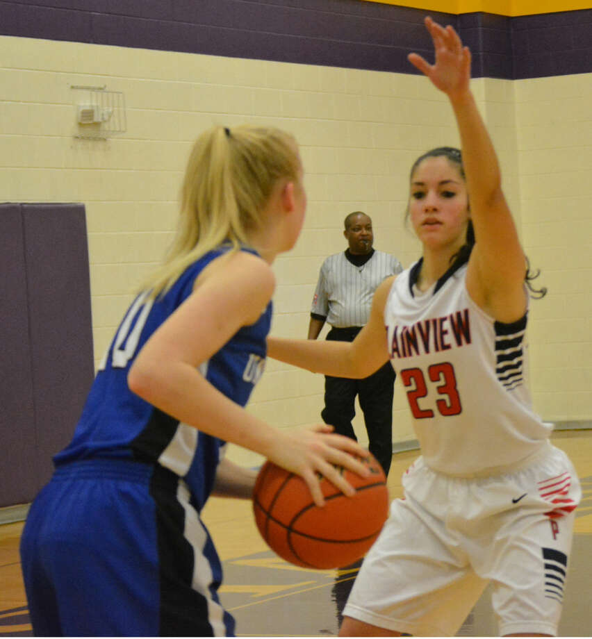 Plainview's Karli Wheeler defends against a New Braunfels player during the American Bank of Texas Tournament in Marble Falls. Plainview won two of three games, including a 66-36 victory over Marble Falls High Saturday, to take third place in the Silver Bracket. Wheeler was an All-Tournament selection. Photo: Doug McDonough/Plainview Herald
