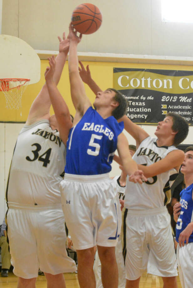 Plainview Christian Academy's Ben Shaw (5) battles for a rebound against Jayton's Junior Martinez (34) and Joey Craig (right) during the Cotton Center Tournament. The Eagles lost their first two games in the tourney and played for seventh place Saturday. Photo: Skip Leon/Plainview Herald