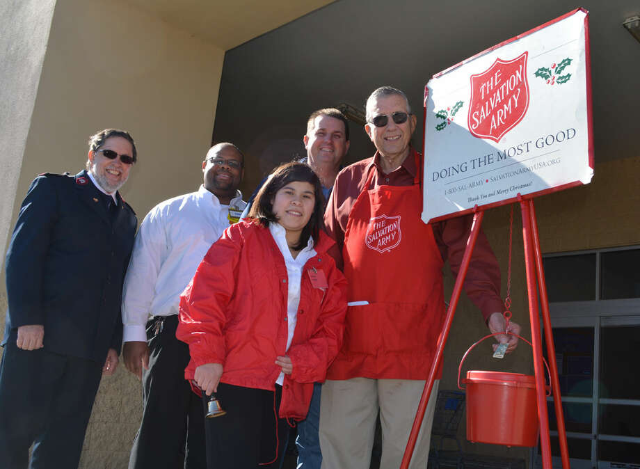 Kettle KickoffDoug McDonough/Plainview HeraldPlainview Mayor Wendell Dunlap was among the first contributors to The Salvation Army Red Kettle Campaign, which kicked off Tuesday. Working the kettle outside Plainview's Walmart Supercenter is Dania Rodriguez. Helping launch this year's effort to raise $50,000 locally during the holiday season are Maj. David Hodge (left), local commander, and Salvation Army Advisory Board members Chris Price, Walmart manager, and Kevin Carter.
