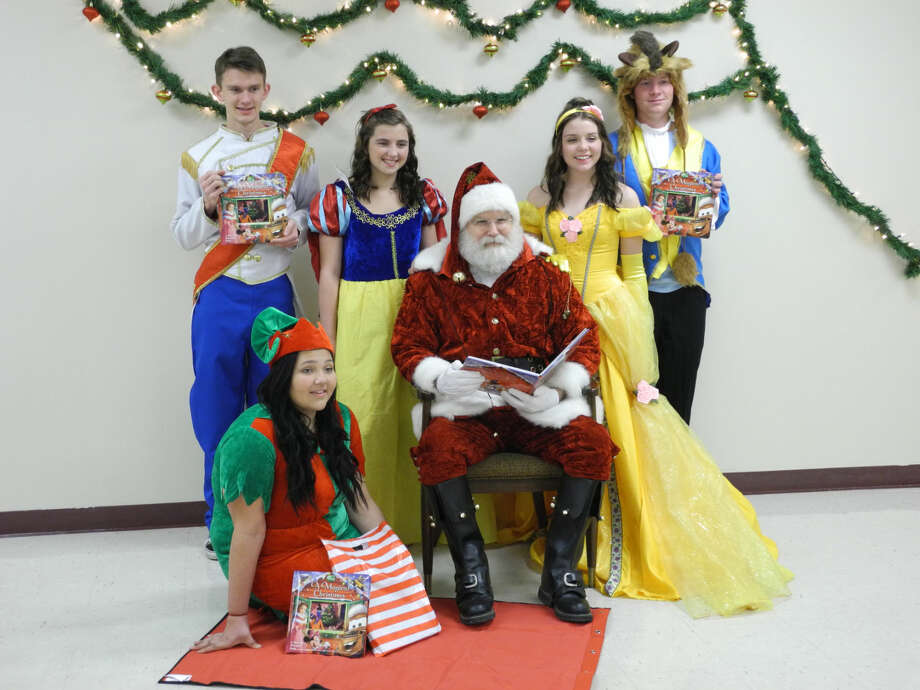 Disney characters, Santa and Elf get ready for the annual Pre-Parade Christmas Party to be held Dec. 4 at the Fair Theatre on Broadway. Pictured are Elf (Lily Garcia, kneeling left), Prince Charming (Matthew Holloway), Snow White (Shalee Lopez), Santa Claus (Rodney Watson), Belle (Jaci Wirth) and Beast (Jeremy Bowen). The party is sponsored by the Hale Council Literacy Council. Photo: Gail M. Williams | Plainview Herald