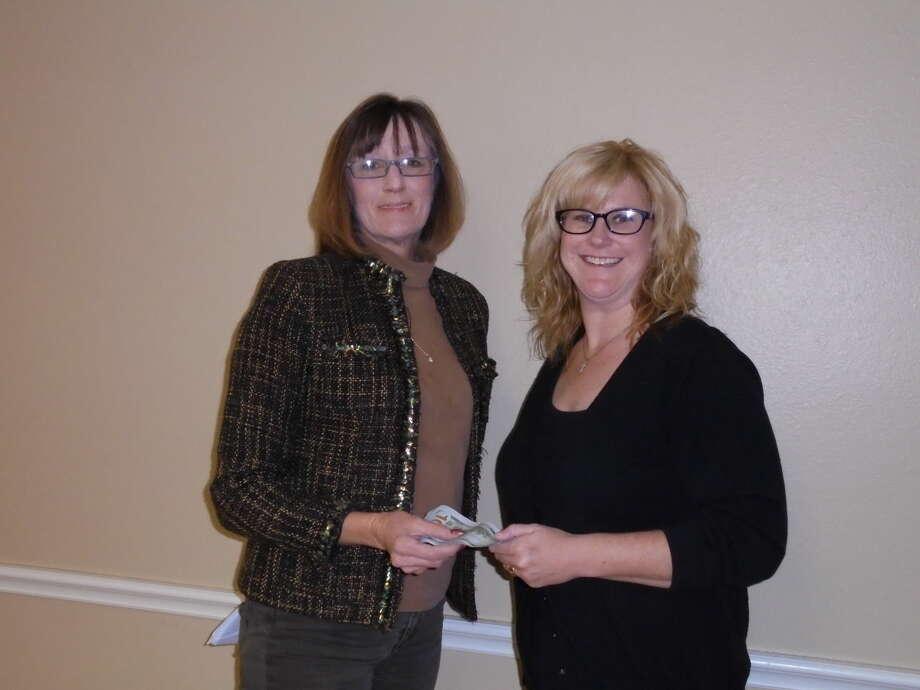 Marci Brown (left), HCRN secretary/treasurer, presents a donation to Melinda Brown, Junior Service League member and HCRN member. Photo: Courtesy Photo | HCRN