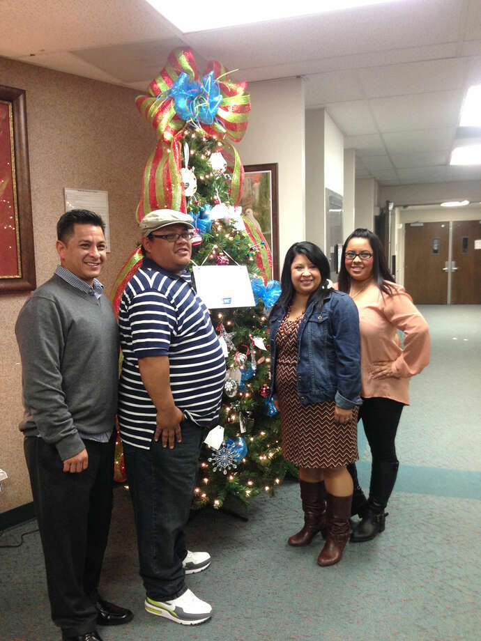 The 2013 American Cancer Society's Tree of Hope honored the memory of Hope Landeros. Pictured are her children, Robert Landeros (left), Charles Landeros, Monica Landeros Hernandez and Melissa Landeros.