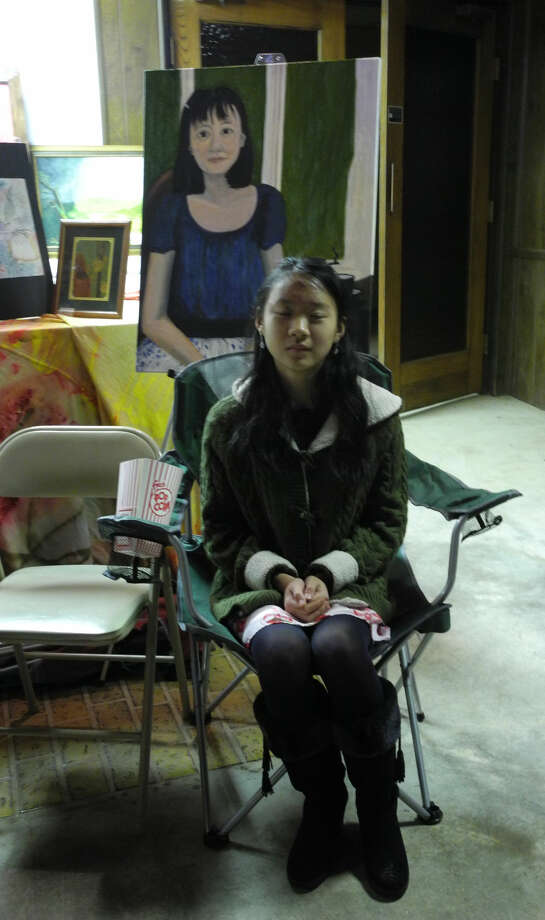 Carrie Huang, 14, is shown with an unfinished portrait of her mother. The Coronado Middle School student has participated in every ArtWalk Plainview since it began. Photo: Gail M. Williams | Plainview Herald
