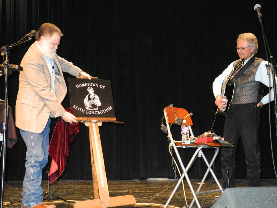 Rodney Watson presents Plainview native and musician Keith Longbotham with a star on the Fair Theatre Walk of Fame at a Christmas concert. Photo: Gail M. Williams | Plainview Herald