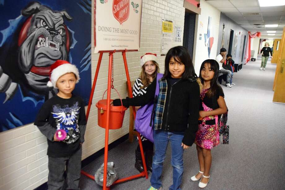 Young Bell RingersJan Seago/Plainview ISDSecond grade students Donovan Frausto (left) and Avary Davis ring bells for the Salvation Army kettle at College Hill Elementary before school on Tuesday. Heather Villalon drops a donation into the kettle as Jade Espinosa waits her turn. Campus food drives to benefit the Salvation Army continue through the week.