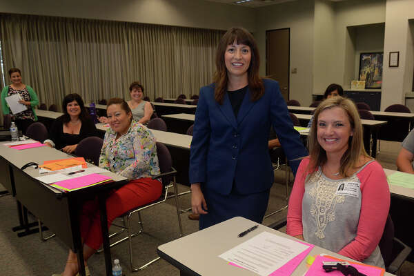 New Humble ISD superintendent Elizabeth Fagen, center, visits with new teachers Tanya Kangasniemi of Atascocita Springs Elementary, left, Maria Vazquez of North Belt Elementary and Terri Thomas of Timbers Elementary during an orientation session at the district office on July 11.