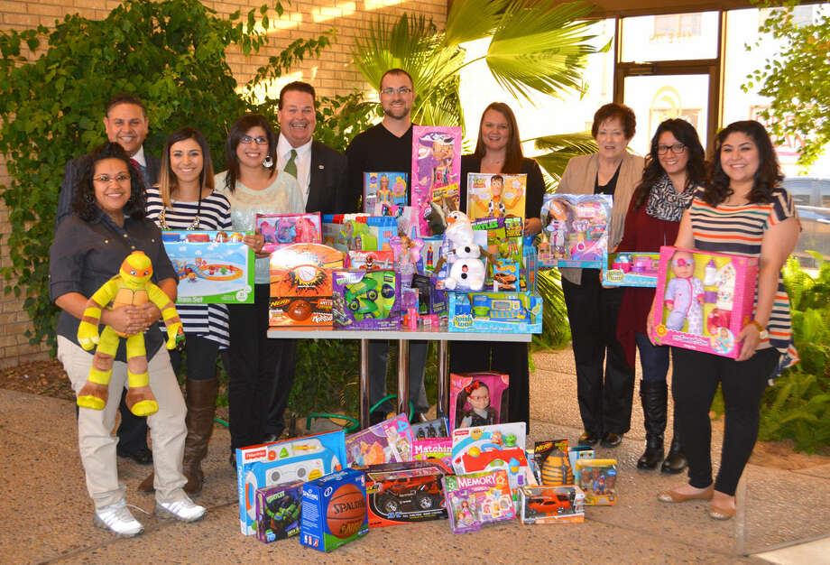 Crisis Center GiftsDoug McDonough/Plainview HeraldFor the fourth consecutive year, local employees of Reagor Dykes Ford Lincoln Toyota have donated children's toys to the Crisis Center of the Plains. The gifts will be distributed free to the children of Crisis Center clients and residents of its safe house through the organization's Christmas Store on the second floor of Broadway Treasures, 513 N. Broadway. The toys were delivered to the Crisis Center on Wednesday. Shown with a portion of the donated items are Stephanie Godino (left), Crisis Center; Joe Landin, Reagor Dykes director of marketing; Jasmine Denton, Reagor Dykes; Eddie Ashburn, Reagor Dykes general manager; Brad Fansler, Reagor Dykes; Millie Duncan, Reagor Dykes; Lou Bevill, Crisis Center; Melinda Morales, Crisis Center; and Brandy Heads, Crisis Center.