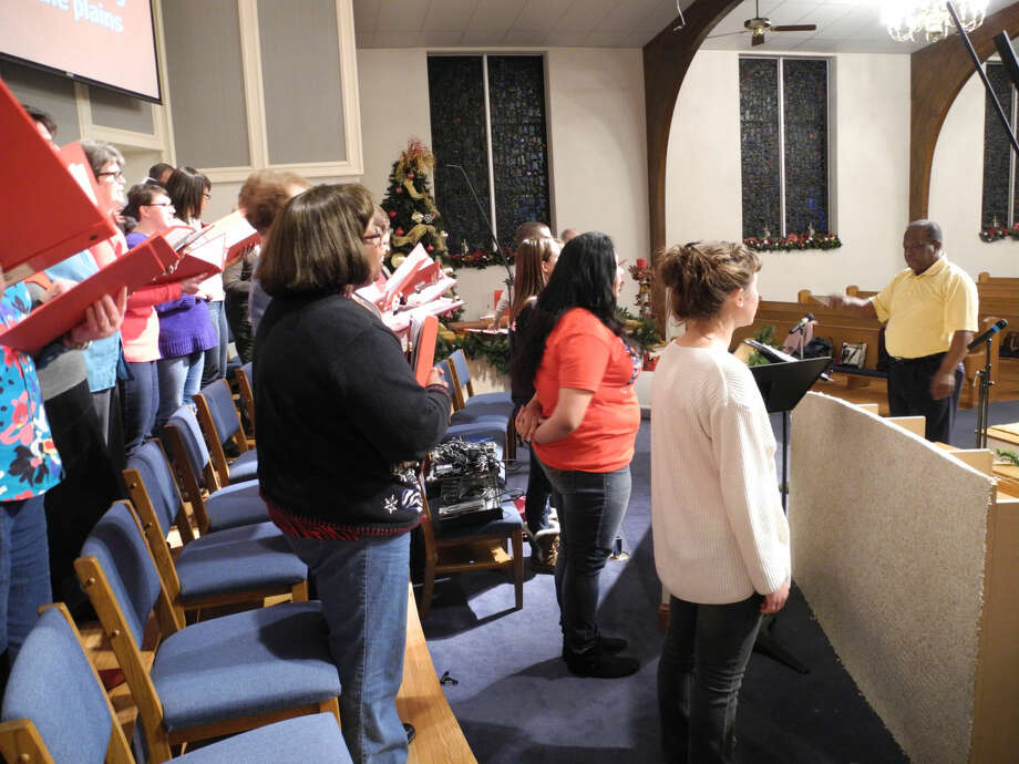 "Choir members directed by Joe Berry sing out at a rehearsal in preparation for the College Heights Baptist Church program ""My Heart Longs for Christmas"" to be presented at 6 p.m. Saturday, Dec. 13, and 10:40 a.m. Sunday, Dec. 14. Photo: Gail M. Williams 