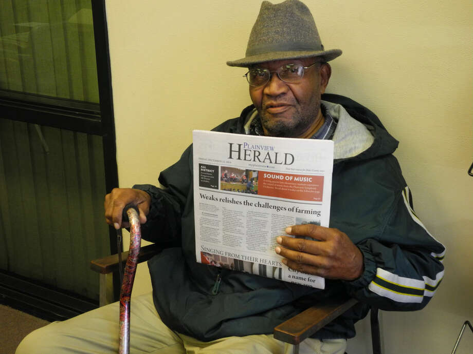 Roy Parr holds up a copy of the Friday issue of the Plainview Herald. The 81-year-old retired from delivering newspapers last week. Photo: Gail M. Williams | Herald Lifestyles Editor