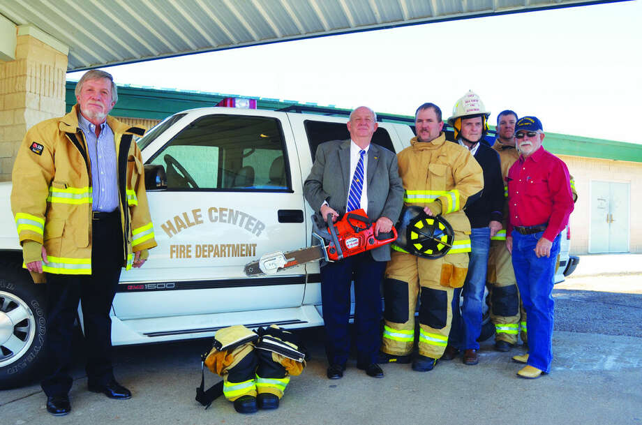 PHILLIP L. HAMILTON/THE AMERICANThe Hale Center Volunteer Fire Department was received a $31,500 grant from the James and Eva Mayer Foundation to purchase protective bunker gear and a rescue saw. Displaying some of the new equipment are foundation trustees Rudd Owen (left) and David Wilder, firefighter Matthew Bell, trustee Paul Lyle, firefighter Shane Rowell and Chief Ronald Groves.