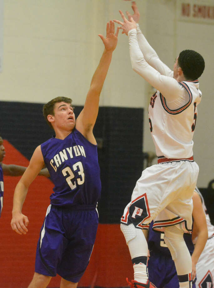Plainview's Jayton Ellis (right) shoots over a Canyon defender in a game earlier this season. Ellis, the 5-foot-8 junior point guard, made the winning shot with three seconds left Tuesday night as the Bulldogs defeated Hereford, 65-61. Photo: Skip Leon/Plainview Herald
