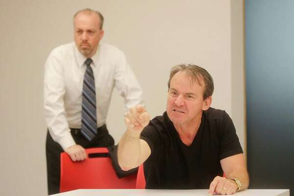 """Trevor B. Cone, left, and Kevin Daugherty rehearse a scene from """"A Steady Rain,"""" an intense two-person drama that uses music as a """"third character"""" onstage during the performance."""