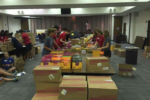 Volunteers help package school supplies last year for low-income students in Spring Branch ISD.