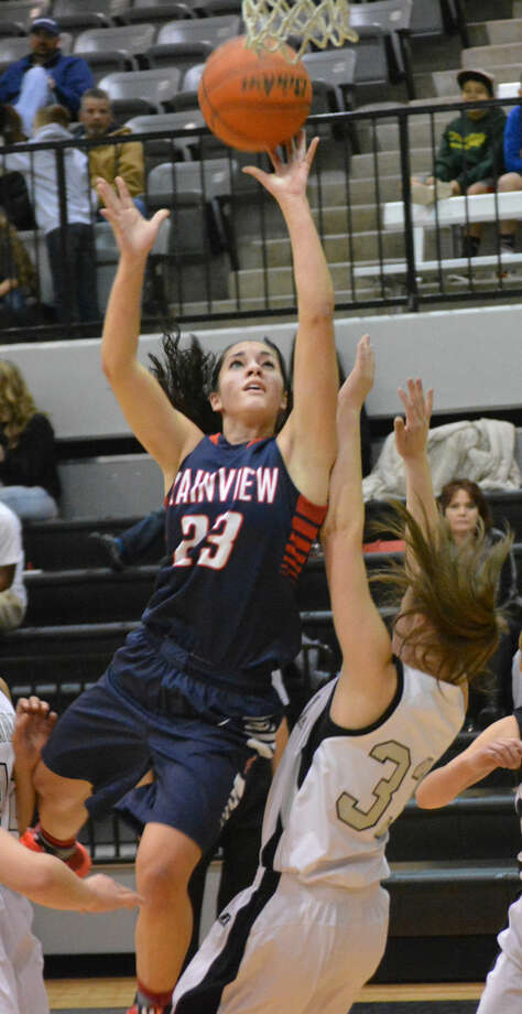 Plainview's Karli Wheeler (23) drives to the basket against Randall Friday night. Wheeler scored 26 points to lead the Lady Bulldogs to a 69-54 victory. Photo: Doug McDonough/Plainview Herald
