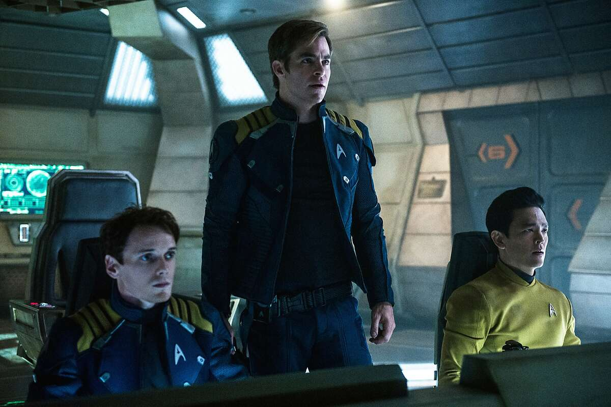 """In this image released by Paramount Pictures, from left, Anton Yelchin, Chris Pine and John Cho appear in a scene from, """"Star Trek Beyond."""" The movie releases in the U.S. on July 22, 2016. (Kimberley French/Paramount Pictures via AP)"""