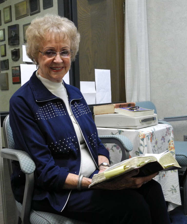 Mary Lou Haygood, who teaches The Searchers class at First Baptist Church Plainview, holds her well-worn NIV Bible. She believes the wise men should be kept separate from the manger scene when the Christmas story is told. Photo: Gail M. Williams/Plainview Herald