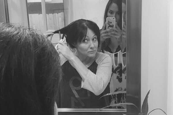 Shannen Doherty posted several pictures on Instagram Tuesday night showing her in various stages of cutting off her hair. She has shaved her head amid a battle with breast cancer.