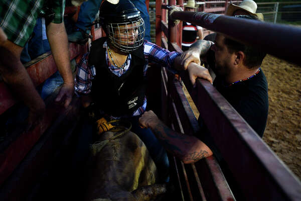 Harley Hudson, 17, talks to her uncle, Philip Alford, before her first time riding a bull during the Bibles and Bulls youth rodeo practice at the Jasper County Cowboy Church, Tuesday, July 12, 2016.  Photo taken Tuesday 7/12/16 Ryan Pelham/The Enterprise