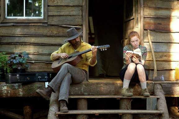 "In this image released by Bleecker Street,  Viggo Mortensen, left, and Annalise Basso appear in a scene from, ""Captain Fantastic."" (Wilson Webb/Bleecker Street via AP)"