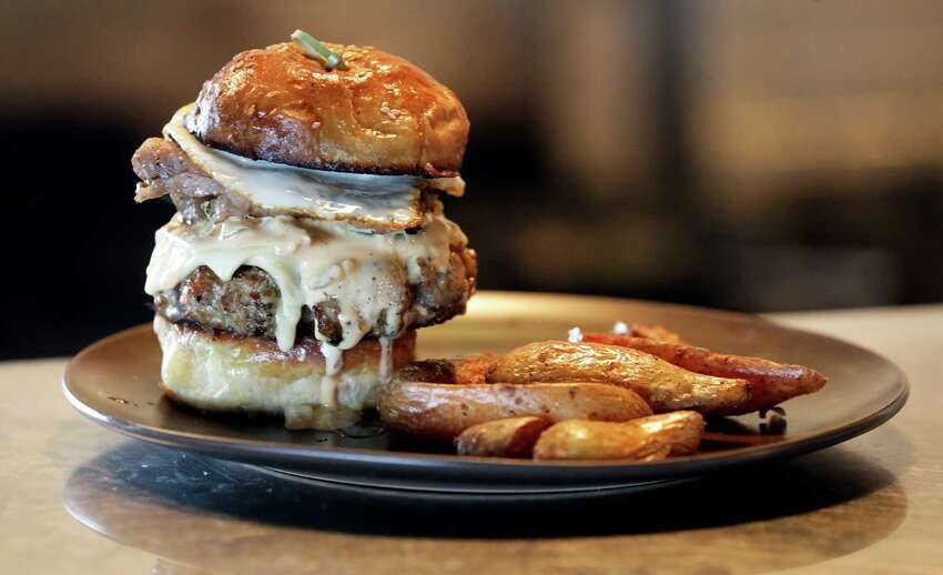 Folc's brisket burger with pork belly and a fried egg was named the best burger in Texas by Texas Monthly magazine.