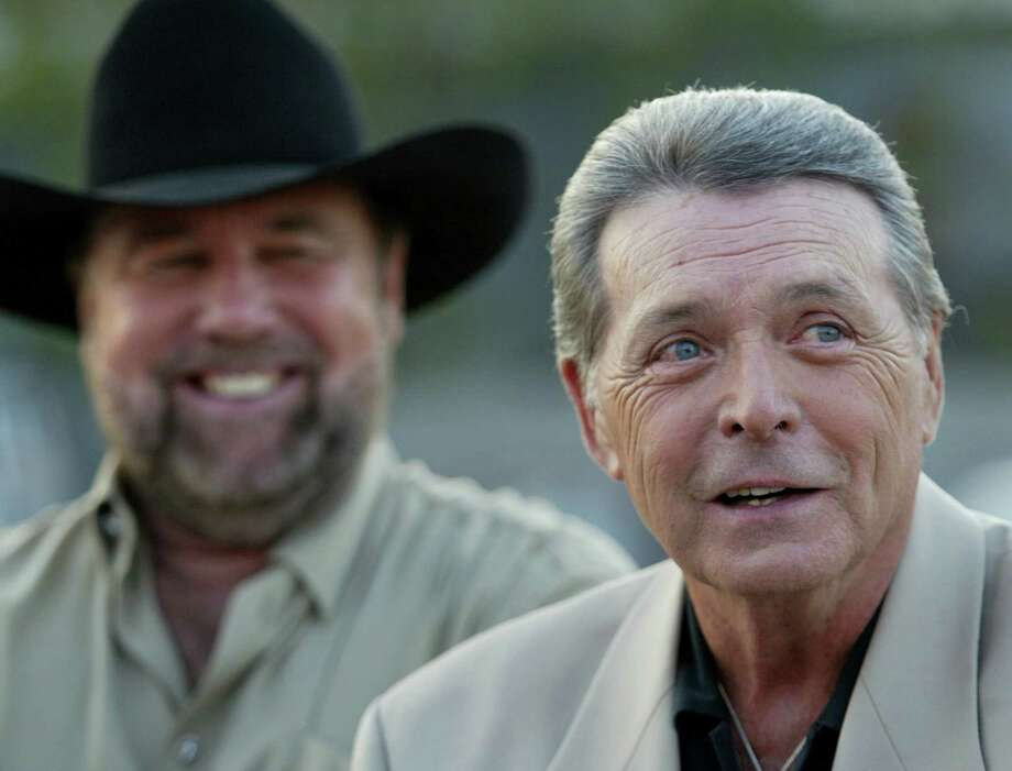 "After the release of ""Urban Cowboy"" in 1980, the careers of Johnny Lee, left, and Mickey Gilley went into overdrive. Both would go on to hit the country charts on a regular basis during the next decade. Photo: MEI-CHUN JAU, MBR / THE DALLAS MORNING NEWS"