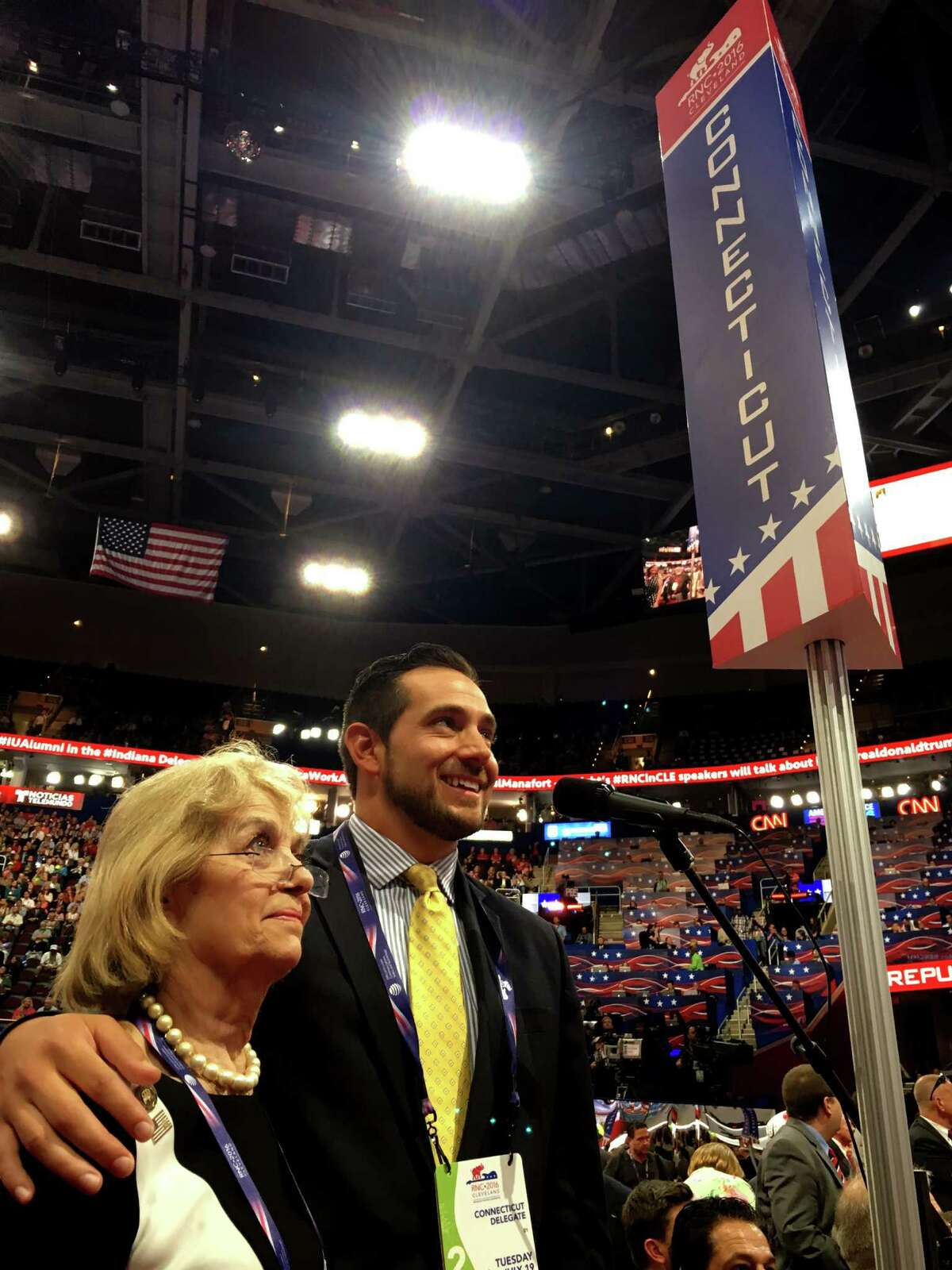 State GOP Chairman J.R. Romano puts his arm around Pat Longo, a Republican National Committee member from Norwalk, Conn. before Connecticut takes its turn during the delegate roll call for Donald Trump in Cleveland, OH on July 19, 2016.