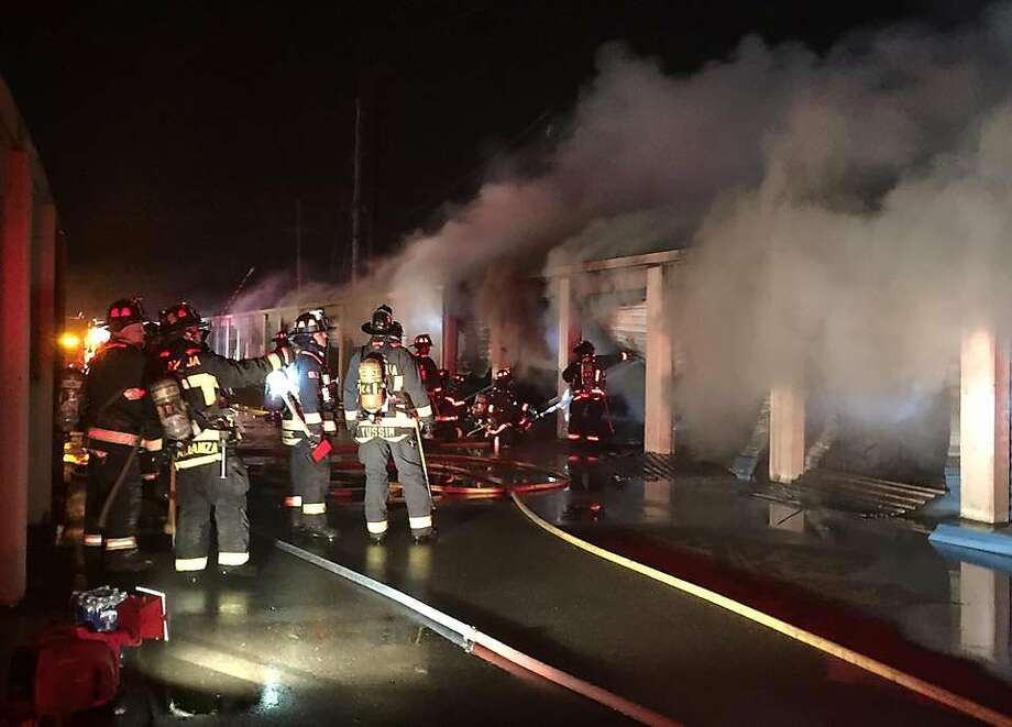 Firefighters battled an early morning blaze Wednesday that ripped through a self-storage facility on Singleton Avenue in Alameda. Photo: Handout, Courtesy Alameda Fire Department