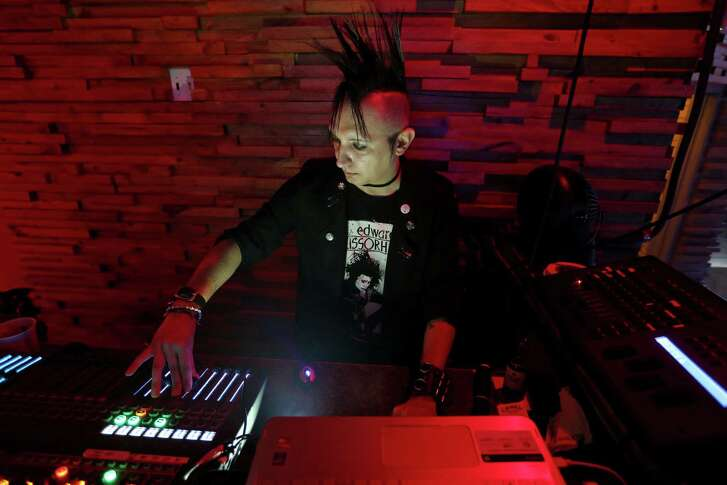 """DJ Ely """"Ely Bat"""" Esparza performs at the Amp Room."""