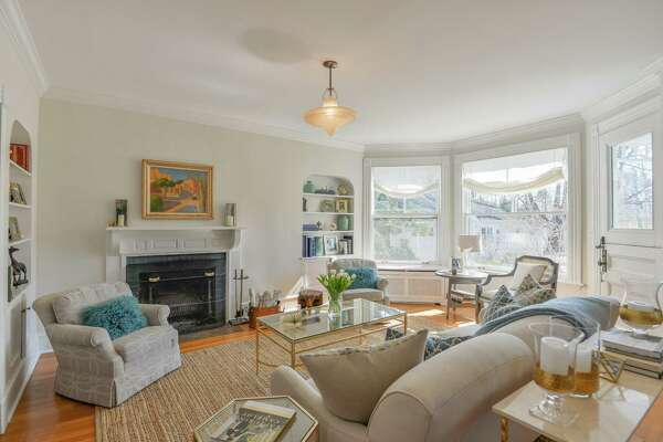 This living room of the antique Victorian house currently on the market in Westport.