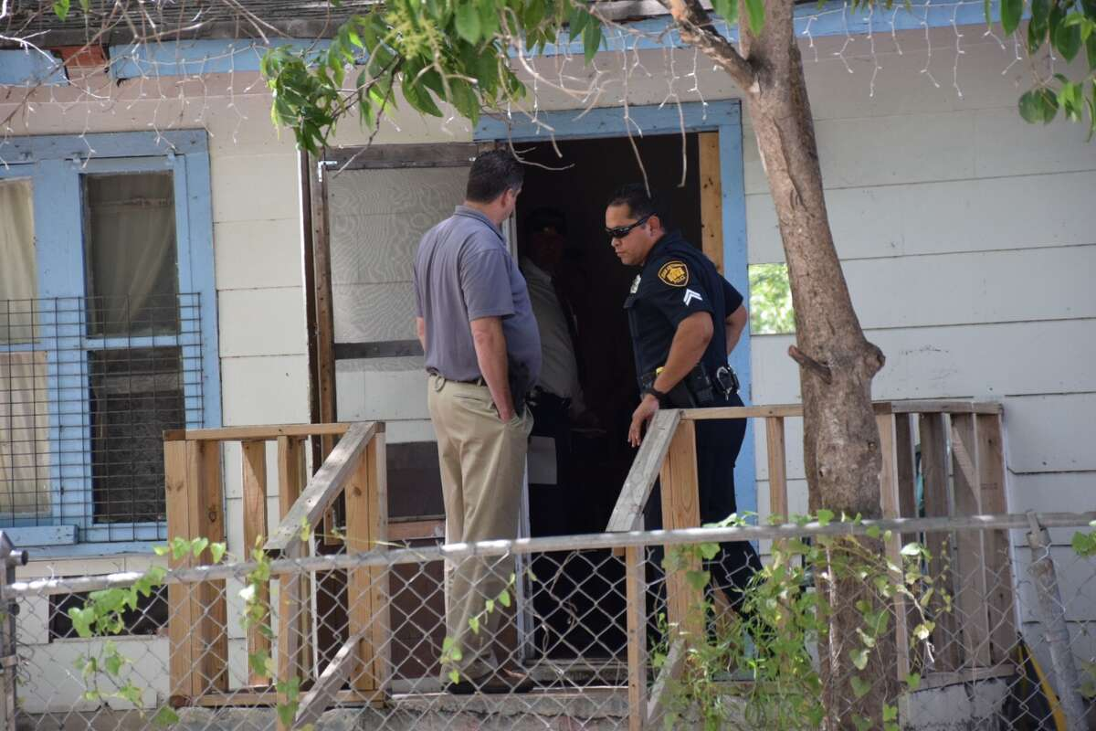 Police investigate a shooting at the 300 block of West Grayson Street, a few blocks from the Pearl Brewery, on Wednesday, July 20, 2016.
