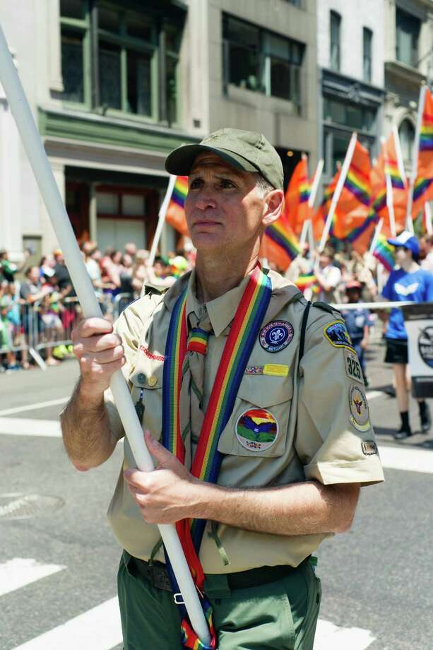 This Sunday, June 26, 2016 photo provided by Brian Gorman shows Greg Bourke from Louisville, Ky., marching in the gay pride parade in New York. Bourke went public with details of how the Archdiocese of Louisville refused to reinstate him as a leader of a Catholic-sponsored Scout troop despite the Boy Scouts of America National Executive Board's decision to end a long-standing blanket ban on participation by openly gay adults. (Brian Gorman via AP) Photo: Brian Gorman, AP / 2016, Brian Gorman, All Rights Reserved