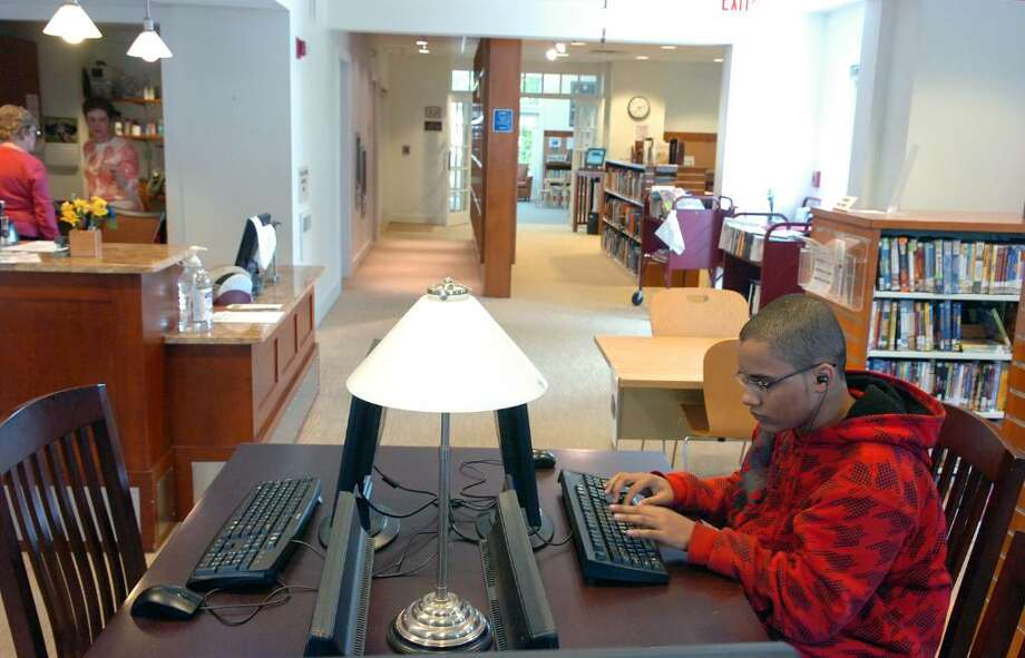 Tyree Howard, 14, uses a computer at  Stamford Library's Weed Memorial & Hollander Branch Tuesday afternoon April 27, 2010.  City lawmakers are pressuring the Board of Finance to return $1.2 million to the budget to prevent library branch closures and reduced hours but Board of Finance chair Joe Tarzia said the city charter prohibits such a move. Photo: Keelin Daly / Stamford Advocate