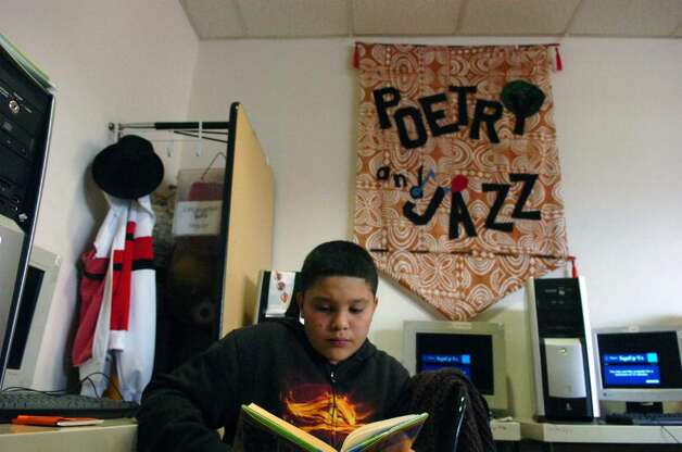 Ryan Sandoval, 10, studies with the CTE After School Academy's fourth and fifth grade reading club at Stamford Library's South End Branch Tuesday afternoon April 27, 2010.  City lawmakers are pressuring the Board of Finance to return $1.2 million to the budget to prevent library branch closures and reduced hours but Board of Finance chair Joe Tarzia said the city charter prohibits such a move. Photo: Keelin Daly / Stamford Advocate