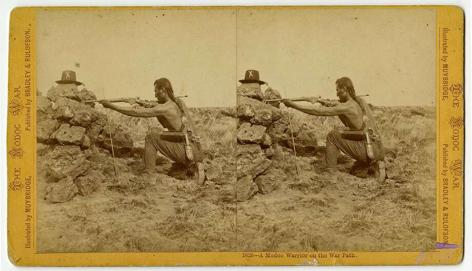 "Eadweard Muybridge, ""A Modoc Warrior on the War Path"" (1873), a posed stereograph from the series The Modoc War. Photo: Photographer: Muybridge, California Historical Society"