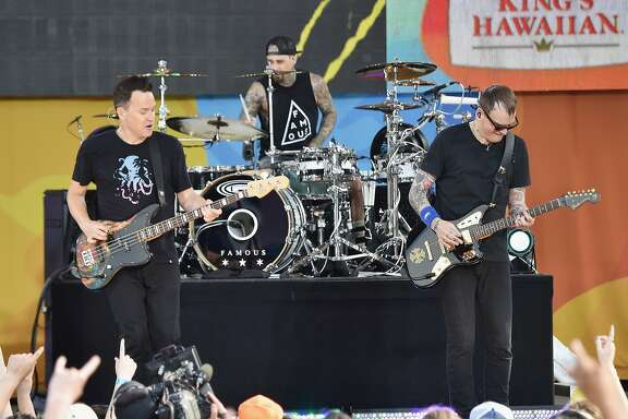 "NEW YORK, NY - JULY 01:  (L-R)  Mark Hoppus, Travis Barker, and  Matt Skiba of the band Blink 182 perform on ABC's ""Good Morning America"" at SummerStage at Rumsey Playfield, Central Park on July 1, 2016 in New York City.  (Photo by Mike Coppola/Getty Images)"