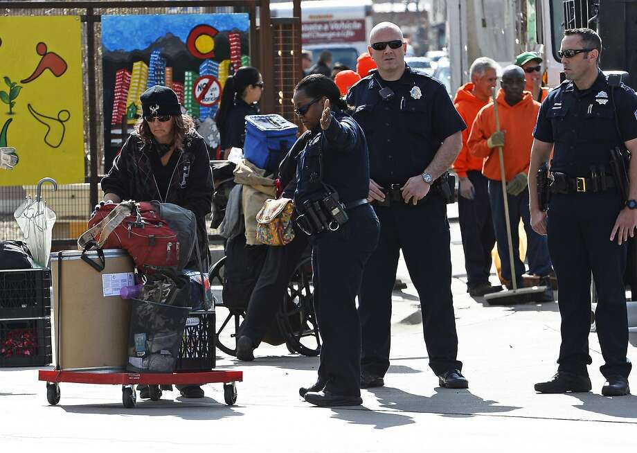 Homeless people remove their belongings as Denver police and sheriff deputies enforce the law. Photo: Helen H. Richardson, Denver Post Via Getty Images