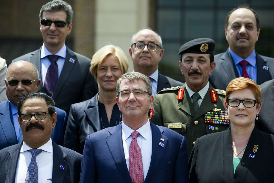 Defense Secretary Ash Carter (center) poses with meeting attendees at Andrews Air Force base, Md. Photo: Cliff Owen, Associated Press